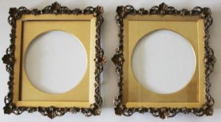 A PAIR OF PICTURE FRAMES Each narrow border with scrolls and flowerheads, shell motifs to the