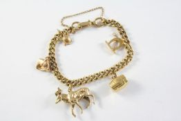 A 9CT GOLD CURB LINK BRACELET suspending five assorted charms, total weight 31.3 grams