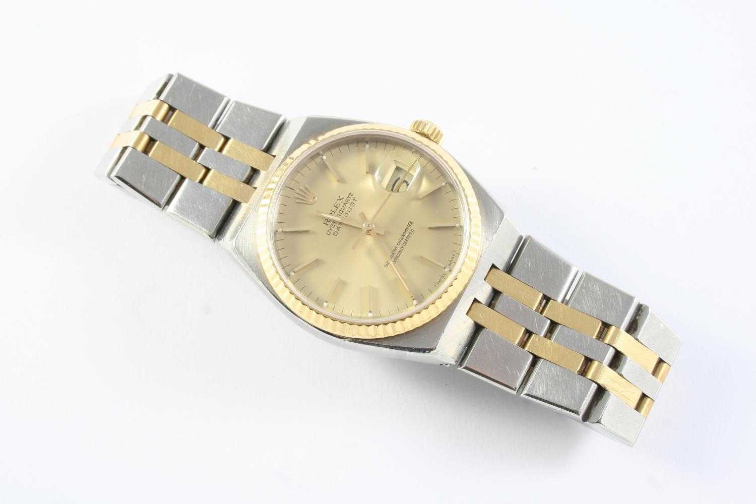 A GENTLEMAN'S STAINLESS STEEL AND GOLD OYSTERQUARTZ DATEJUST WRISTWATCH BY ROLEX the signed gold