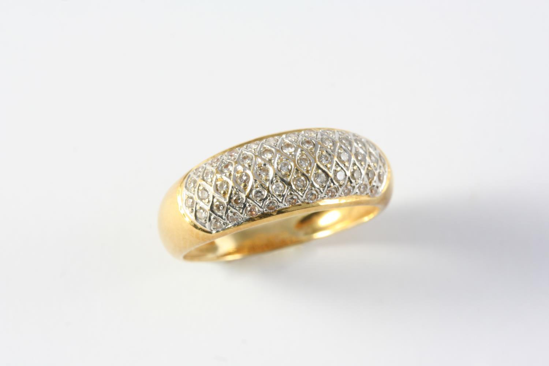 A DIAMOND HALF HOOP RING mounted with circular-cut diamonds, in yellow gold. Size M 1/2