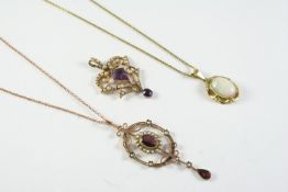 AN EDWARDIAN AMETHYST AND PEARL SET PENDANT the gold openwork mount is centred with a kite-shaped