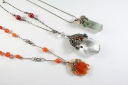 AN ARTS AND CRAFTS SILVER, CRYSTAL,MOONSTONE AND CARNELIAN PENDANT the pear-shaped crystal drop with