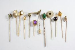 TWENTY SIX ASSORTED STICK PINS a garnet and seed pearl cluster stick pin, a gold stick pin mounted