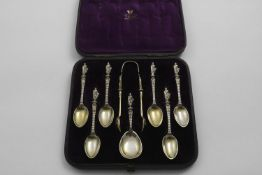 A VICTORIAN CASED SET OF SIX SILVERGILT APOSTLE-TERMINAL TEA SPOONS & MATCHING CADDY SPOON & PAIR OF