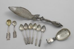 A MIXED LOT:- A set of six tea/coffee spoons with scroll-decorated, paddle-like terminals, by