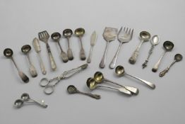 A MIXED LOT;- Fifteen various small spoons (mainly for condiments), a pair of late Victorian sugar