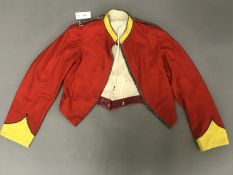 AN ARGYLL HIGHLAND RIFLES MESS JACKET. The red jacket with yellow cuffs and collar with beaded