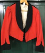 A COLONEL'S MESS JACKET AND WAISTCOAT. A 1902 pattern scarlet mess jacket and waistcoat with