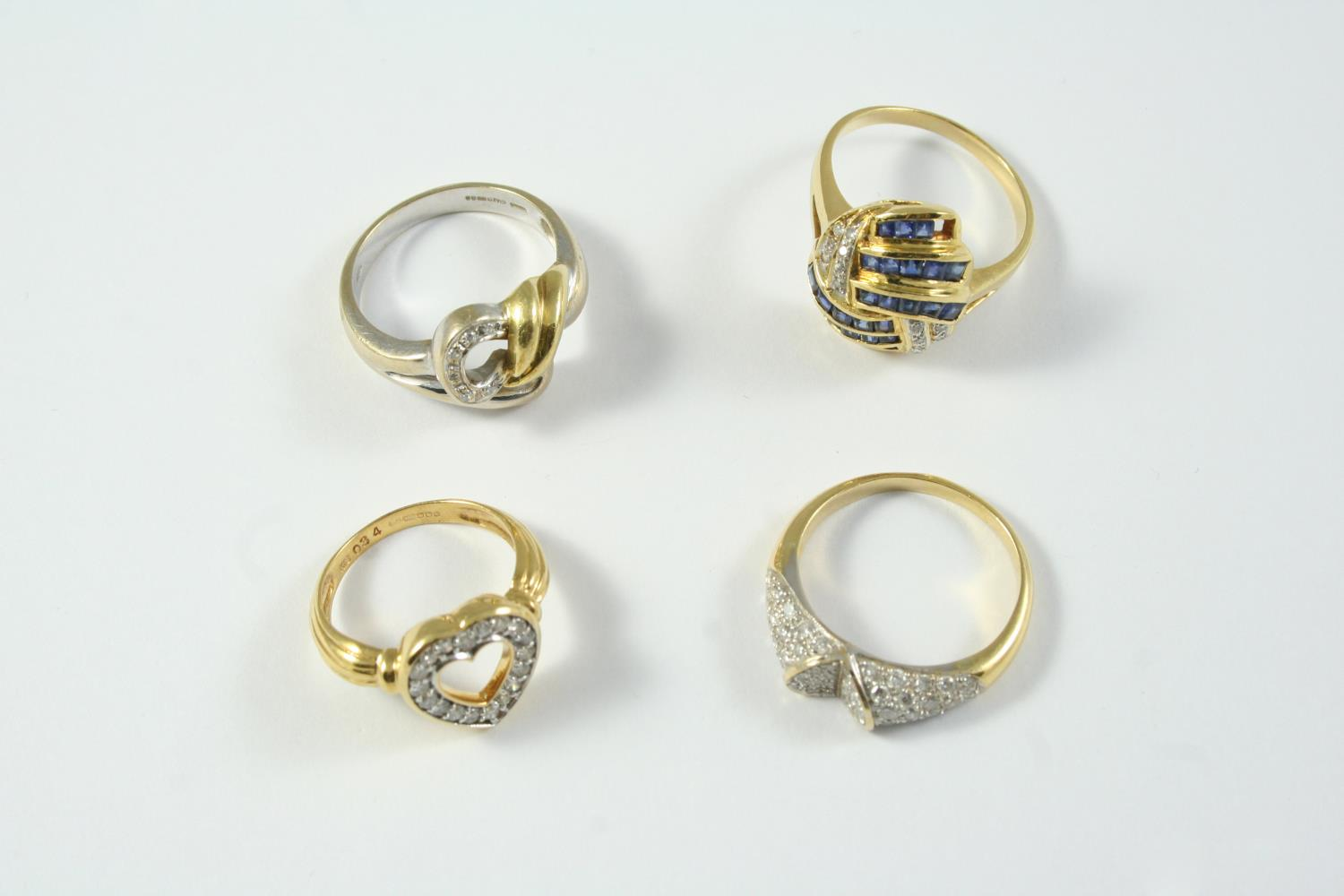AN 18CT TWO COLOUR GOLD AND DIAMOND RING set with circular-cut diamonds, size P 1/2, together with a