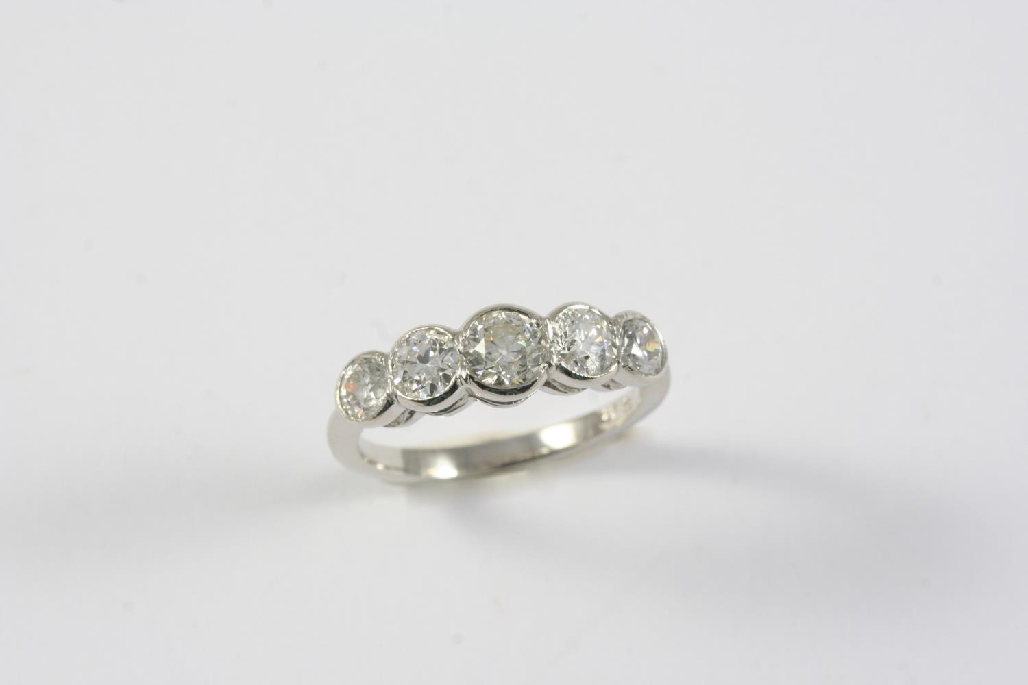 A DIAMOND FIVE STONE RING set with five graduated circular-cut diamonds weighing approximately 1.