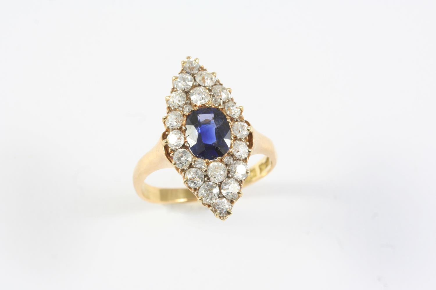 A SAPPHIRE AND DIAMOND MARQUISE-SHAPED CLUSTER RING the oval-shaped sapphire is set within a