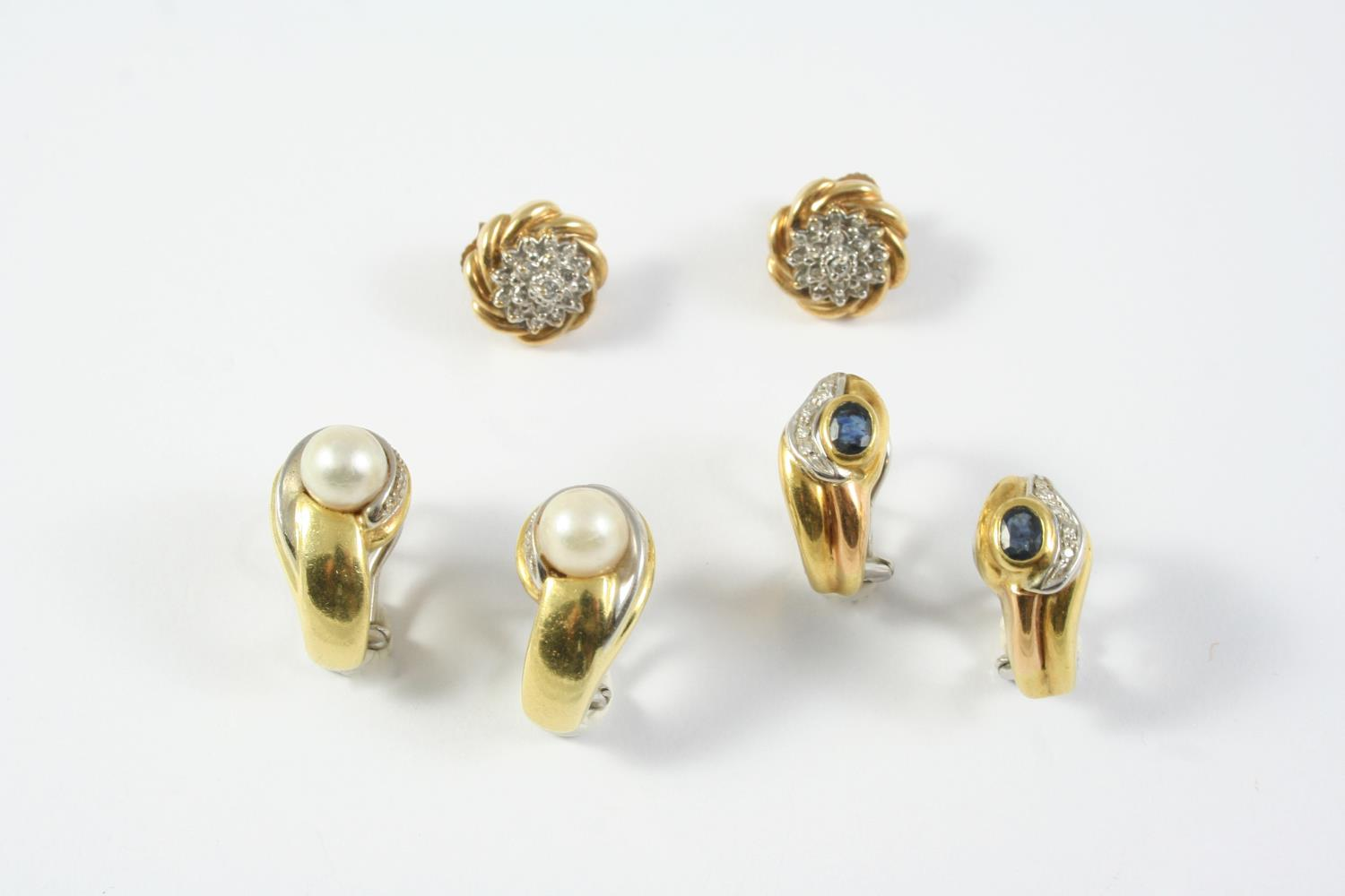 A PAIR OF SAPPHIRE, DIAMOND AND 18CT GOLD EARRINGS each earring set with an oval-shaped sapphire and