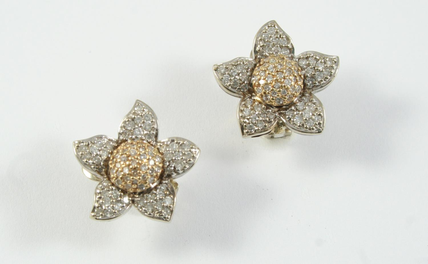 A PAIR OF DIAMOND SET EARRINGS of flowerhead form, each set with circular-cut diamonds, in gold, 2.