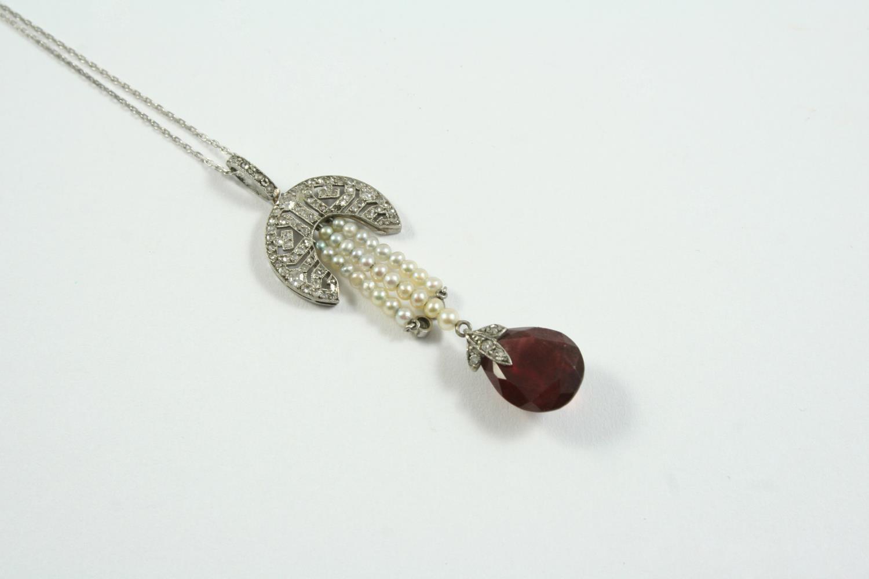 A BELLE EPOQUE GARNET AND DIAMOND PENDANT the rose-cut diamond openwork surmount suspends a pear-