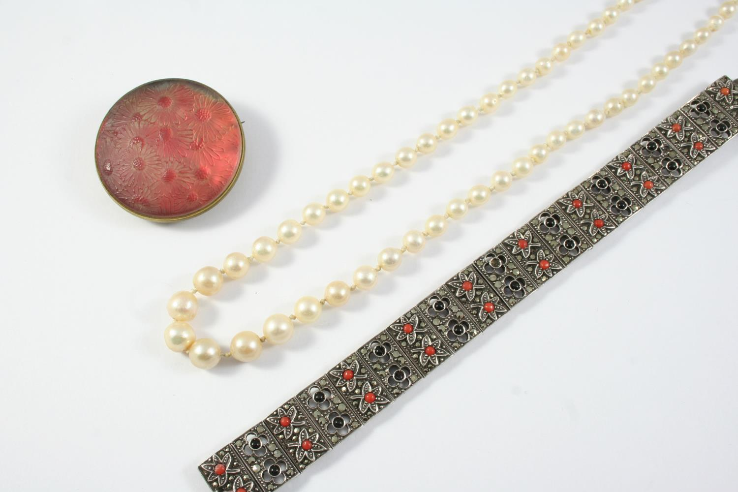 A CULTURED PEARL NECKLACE the pearls graduate from 3.6mm to 7.9mm to a 9ct white gold clasp, 49.