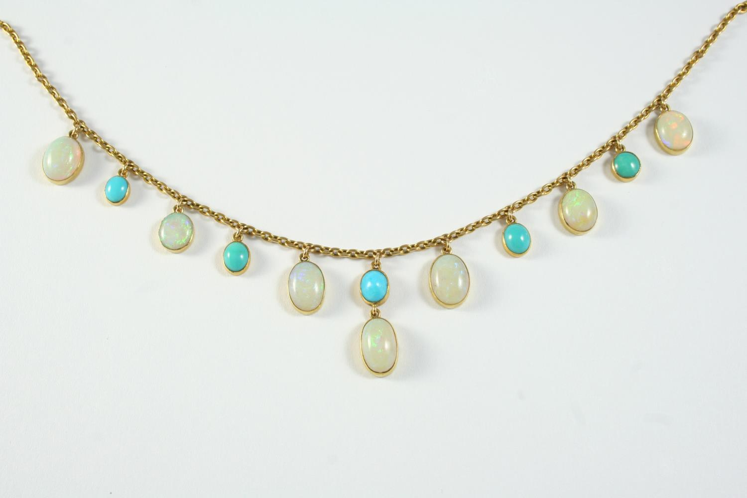 AN OPAL AND TURQUOISE DROP NECKLACE the 9ct gold oval link chain supends seven oval-shaped solid