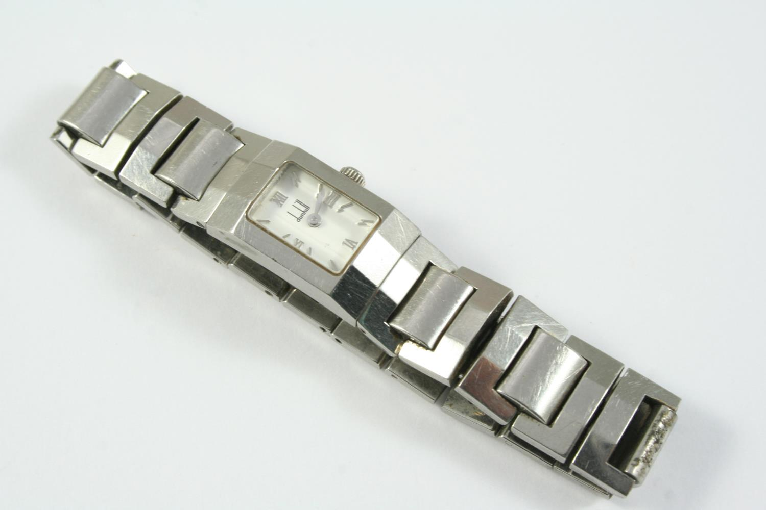 A LADY'S STAINLESS STEEL WRISTWATCH BY DUNHILL the signed white rectangular-shaped dial with Roman