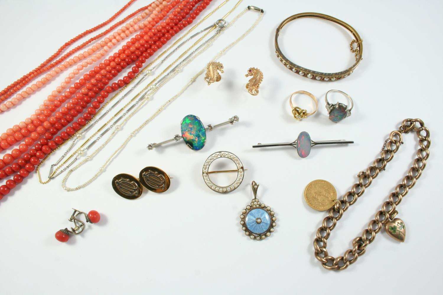 A QUANTITY OF JEWELLERY including three coral bead necklaces, a pair of coral earrings, a pair of