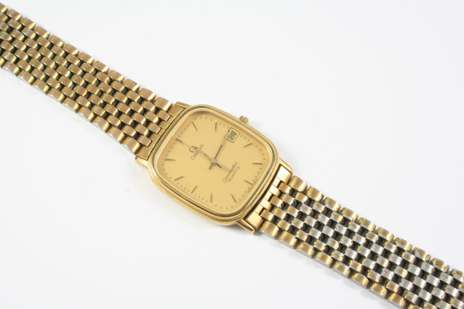 A STAINLESS STEEL AND GOLD PLATED SEAMASTER WRISTWATCH BY OMEGA the signed cushion-shaped dial