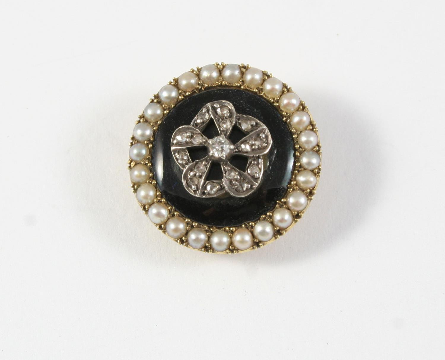 A VICTORIAN DIAMOND, PEARL AND BLACK ENAMEL BROOCH of circular form, the black enamel centre mounted