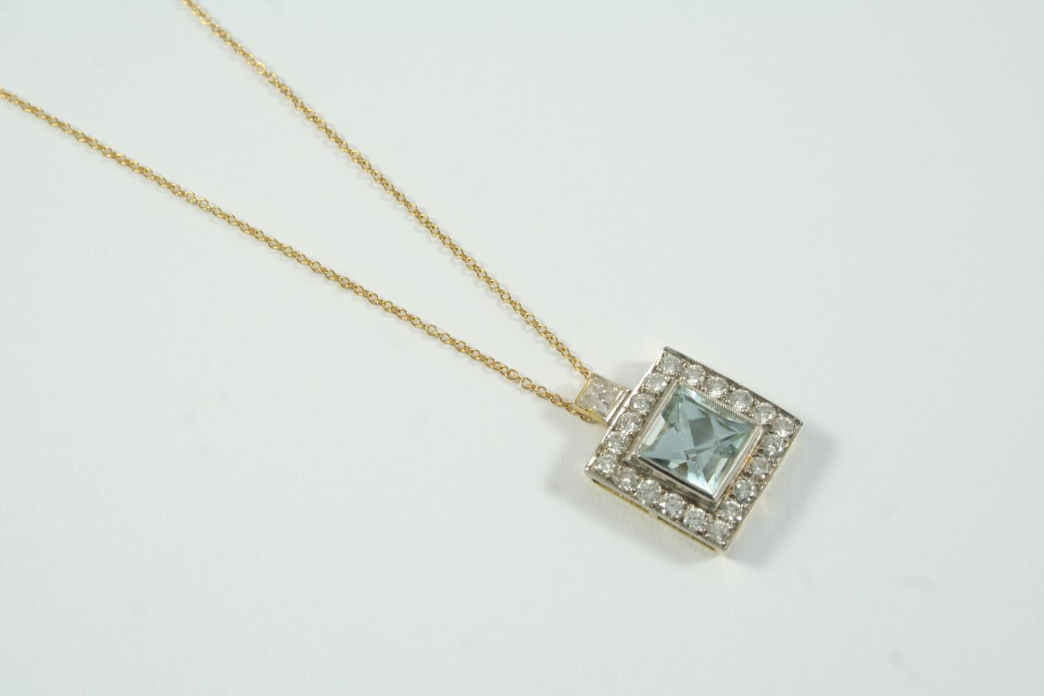 AN AQUAMARINE AND DIAMOND CLUSTER PENDANT the square-shaped aquamarine is set within a surround of