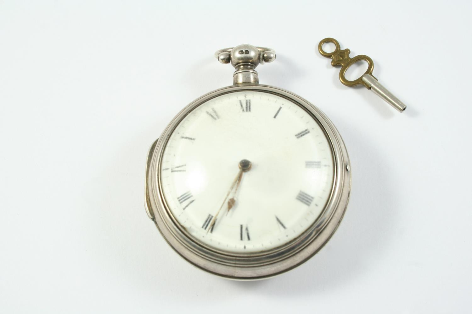 A SILVER PAIR CASED VERGE POCKET WATCH the white enamel dial with Roman numerals, the movement
