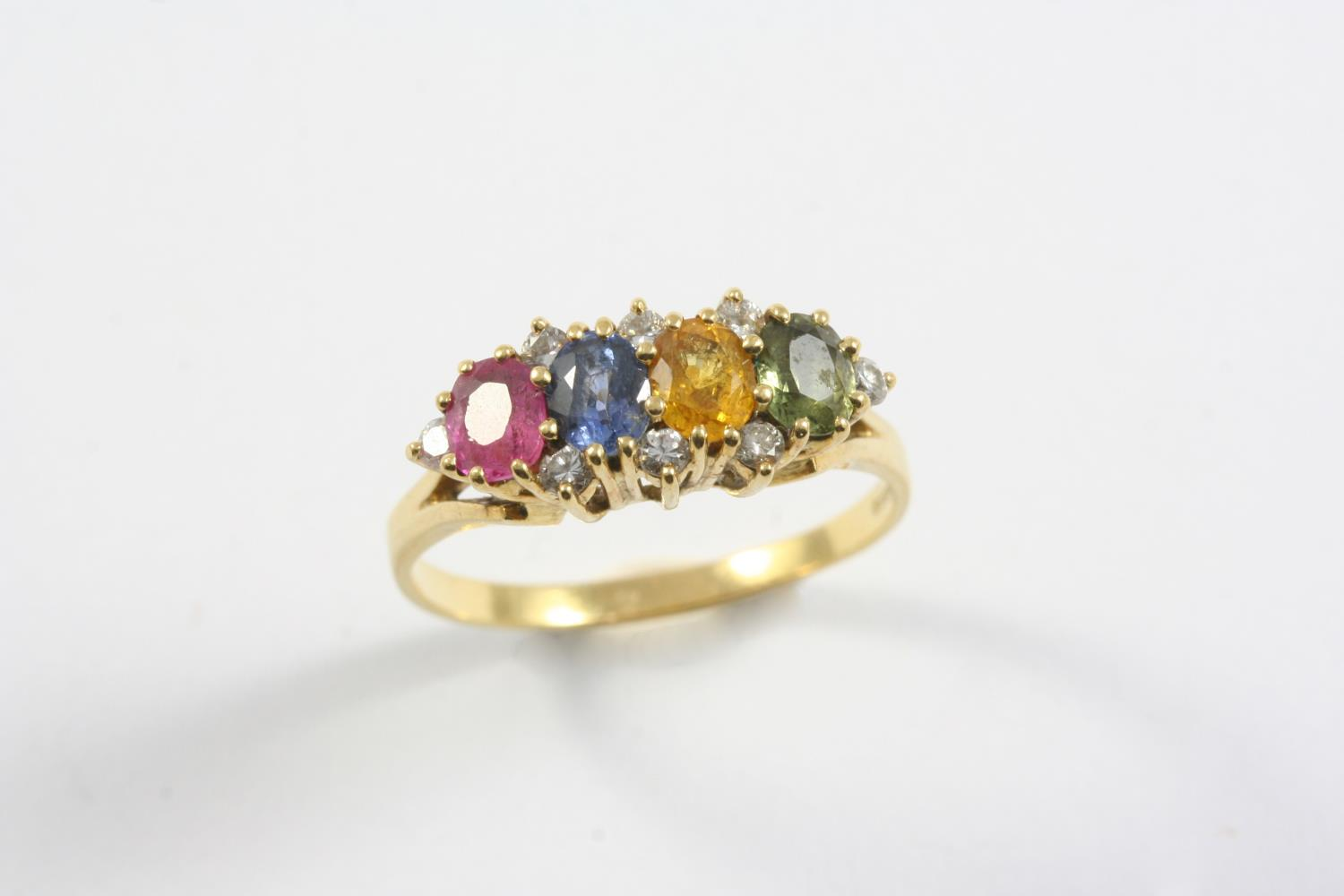 A MULIT COLOURED SAPPHIRE AND DIAMOND RING set with pink, yellow, green and blue oval-shaped