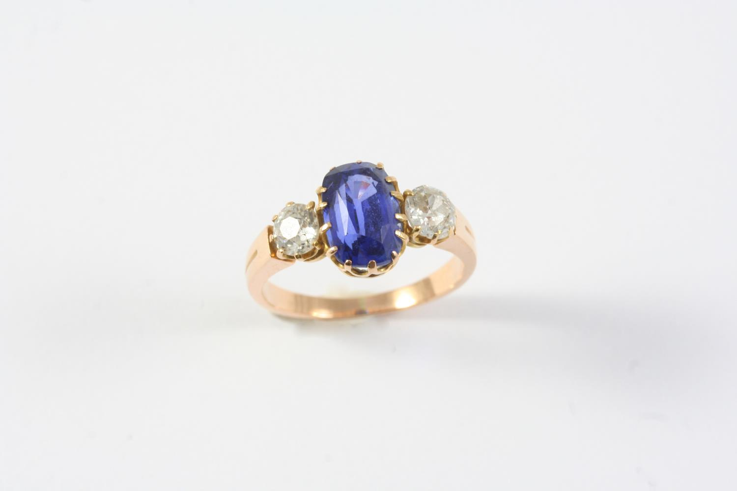 A SAPPHIRE AND DIAMOND THREE STONE RING the oval-shaped sapphire weighs approximately 2.60 carats