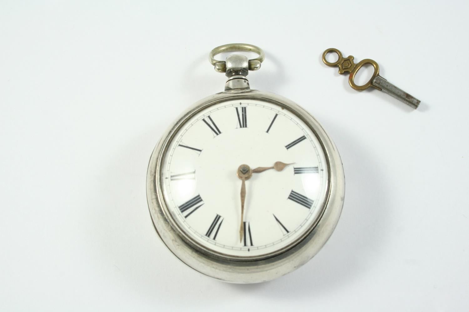 A SILVER PAIR CASED VERGE FUSEE POCKET WATCH the white enamel dial with Roman numerals, the movement