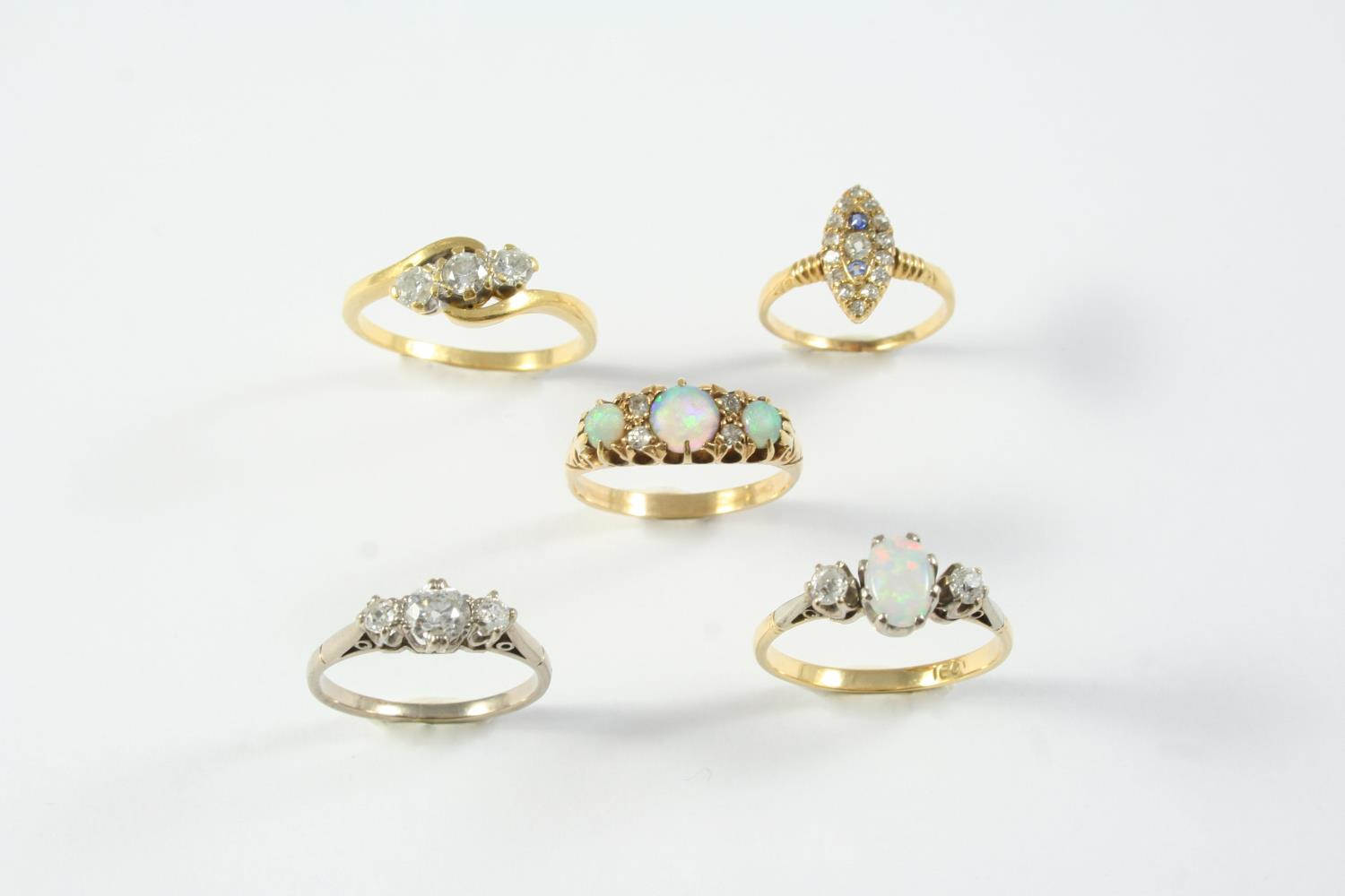 AN OPAL AND DIAMOND THREE STONE RING the oval-shaped solid white opal is set with two circular-cut