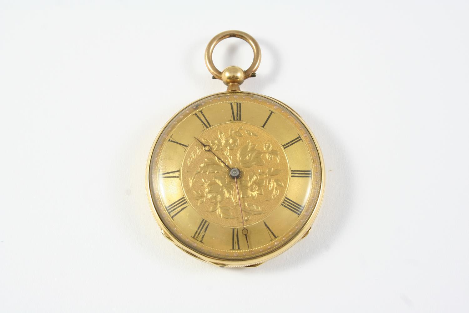 A GOLD OPEN FACED POCKET WATCH the gold foliate engraved dial with Roman numerals, engraved to the