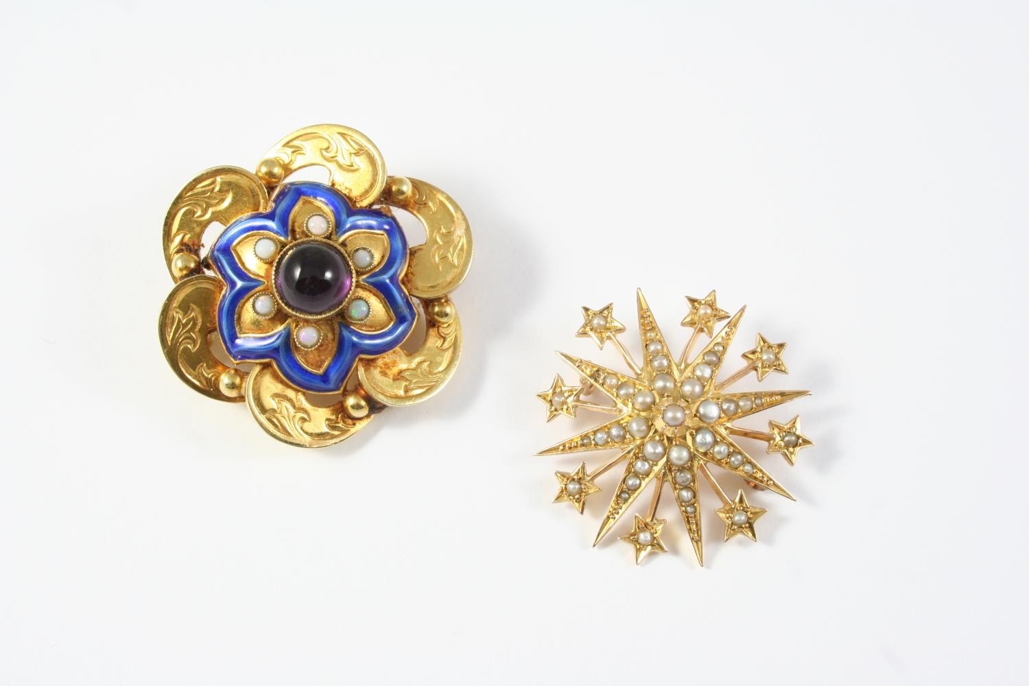 A VICTORIAN GOLD AND GEM SET BROOCH the engraved gold mount with blue enamel decoration is centred