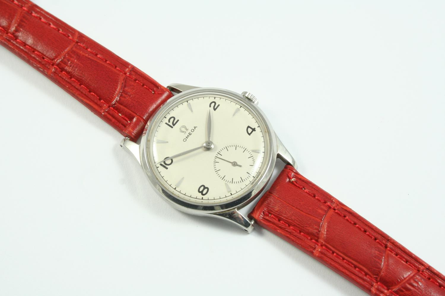 A STAINLESS STEEL WRISTWATCH BY OMEGA the signed circular dial with Arabic and dagger numerals,