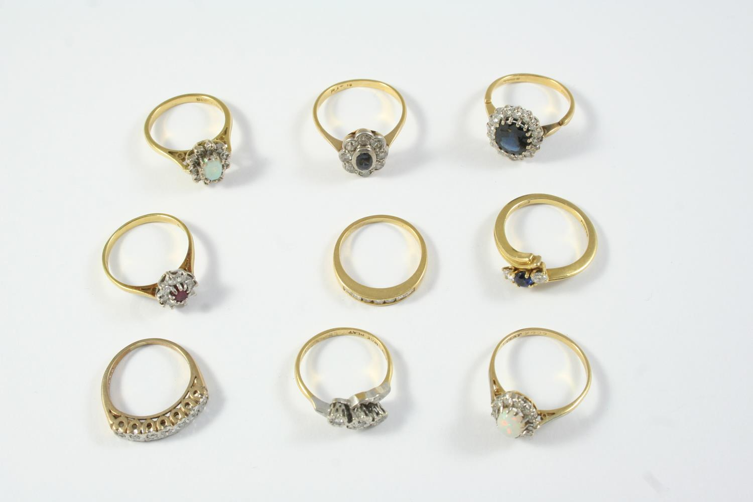 TEN ASSORTED GOLD AND GEM SET RINGS including a sapphire and diamond three stone ring, set in 18ct