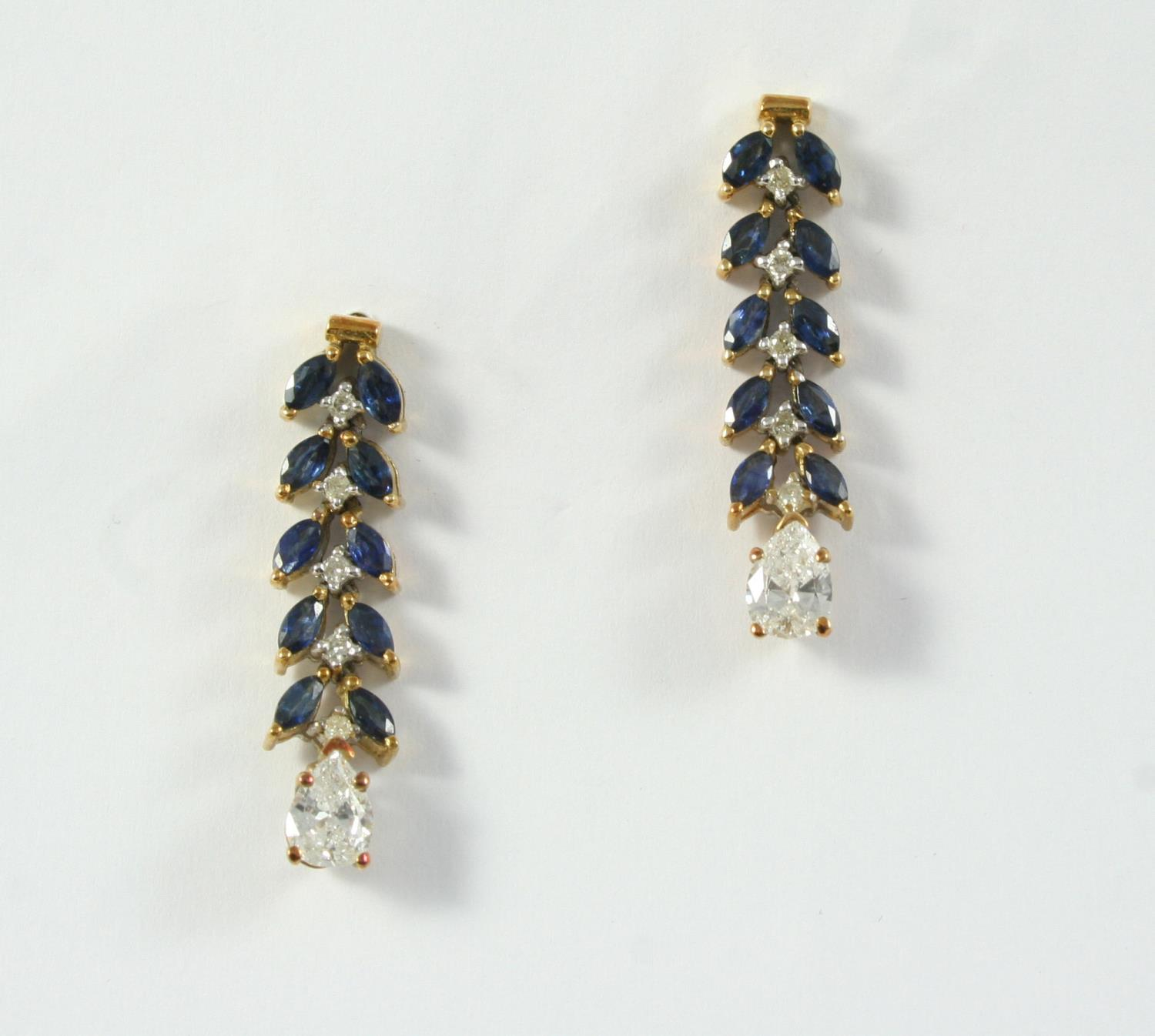 A PAIR OF SAPPHIRE AND DIAMOND DROP EARRINGS of foliate form, each set with line of marquise-cut