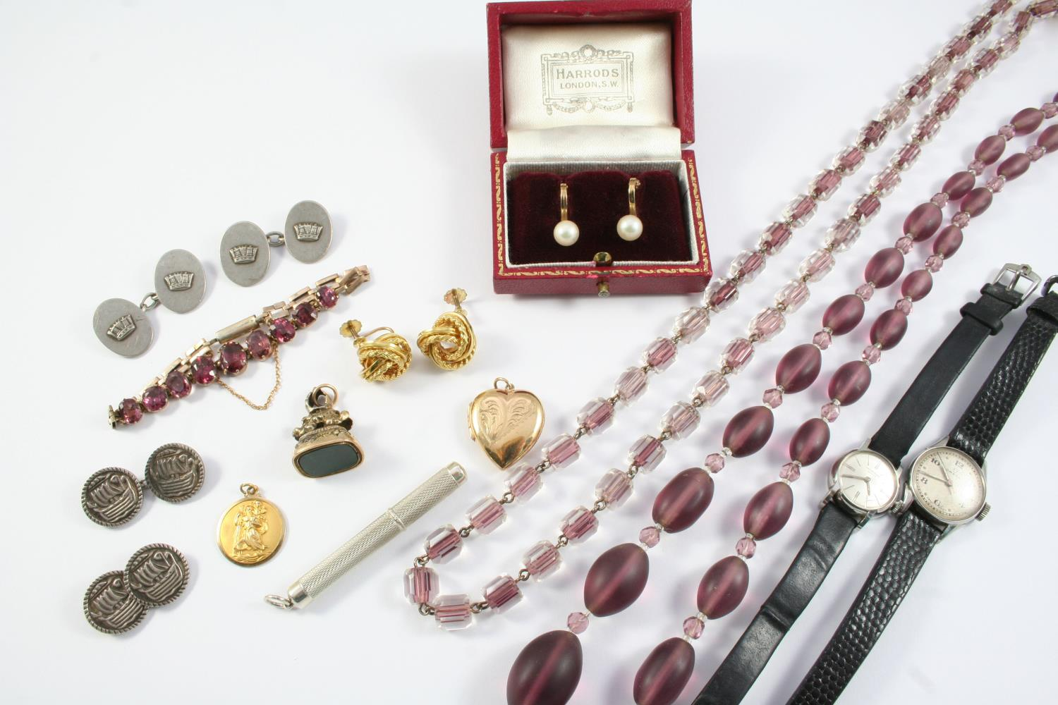 A QUANTITY OF JEWELLERY including a 9ct gold St. Christopher pendant, a pair of 9ct gold knot