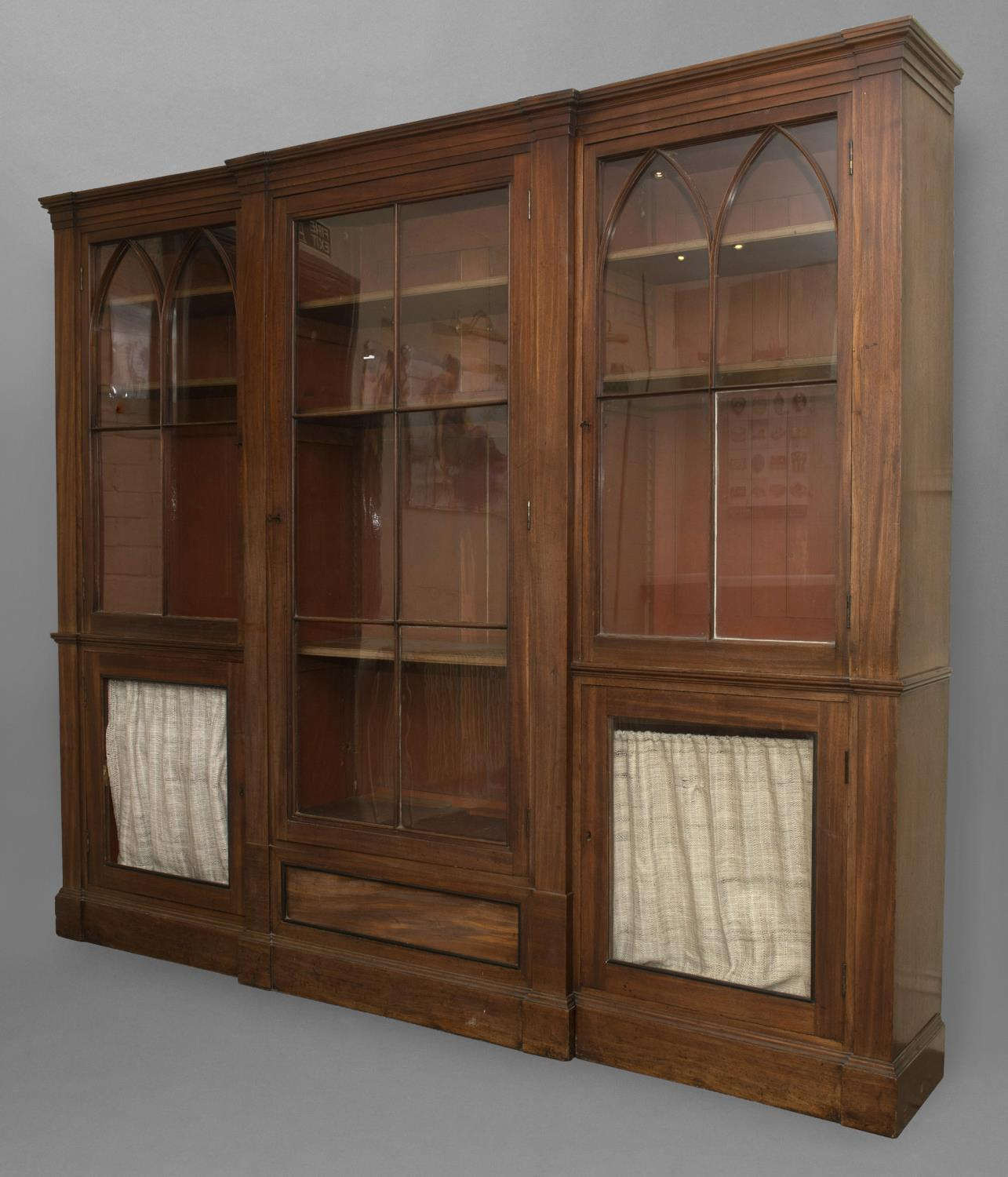 A LATE GEORGE III MAHOGANY LIBRARY BOOKCASE. With a broad central door with six glass panels - Image 2 of 2