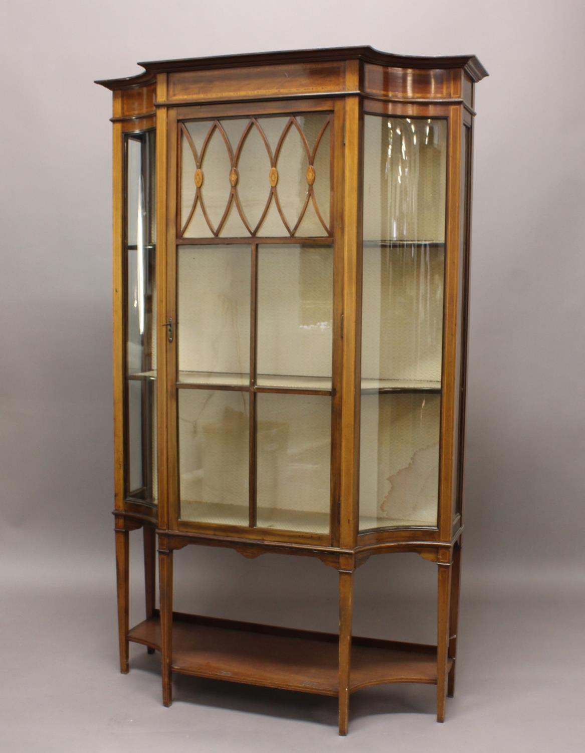 AN EDWARDIAN SHERATON REVIVAL INLAID MAHOGANY DISPLAY CABINET, the central glazed door flanked by