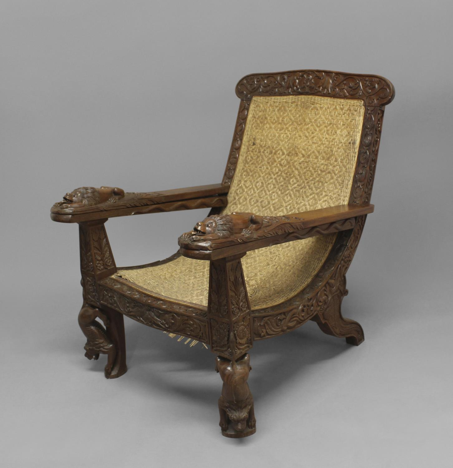 A LATE 19TH/EARLY 20TH CENTURY TEAK PLANTERS CHAIR. A teak planters chair with elaborately carved - Image 2 of 2