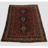 A KHAMSEH CARPET, South West Iran, c.1920, the madder field richly decorated with tribal motifs,