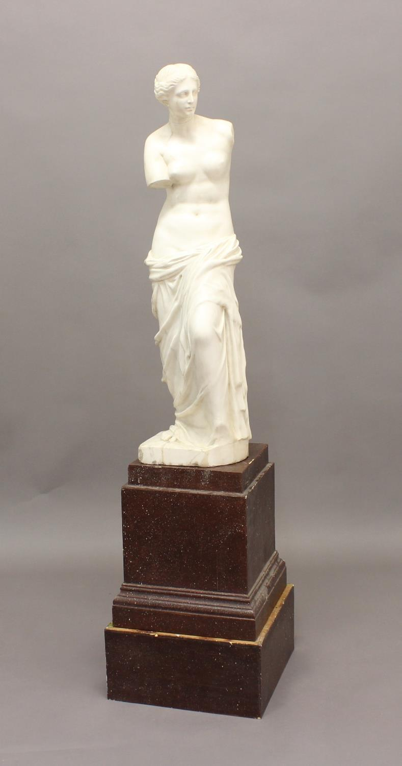 AFTER ALEXANDROS OF ANTIOCH, 'Venus De Milo', a carved marble sculpture, height 89cm on a porphyry