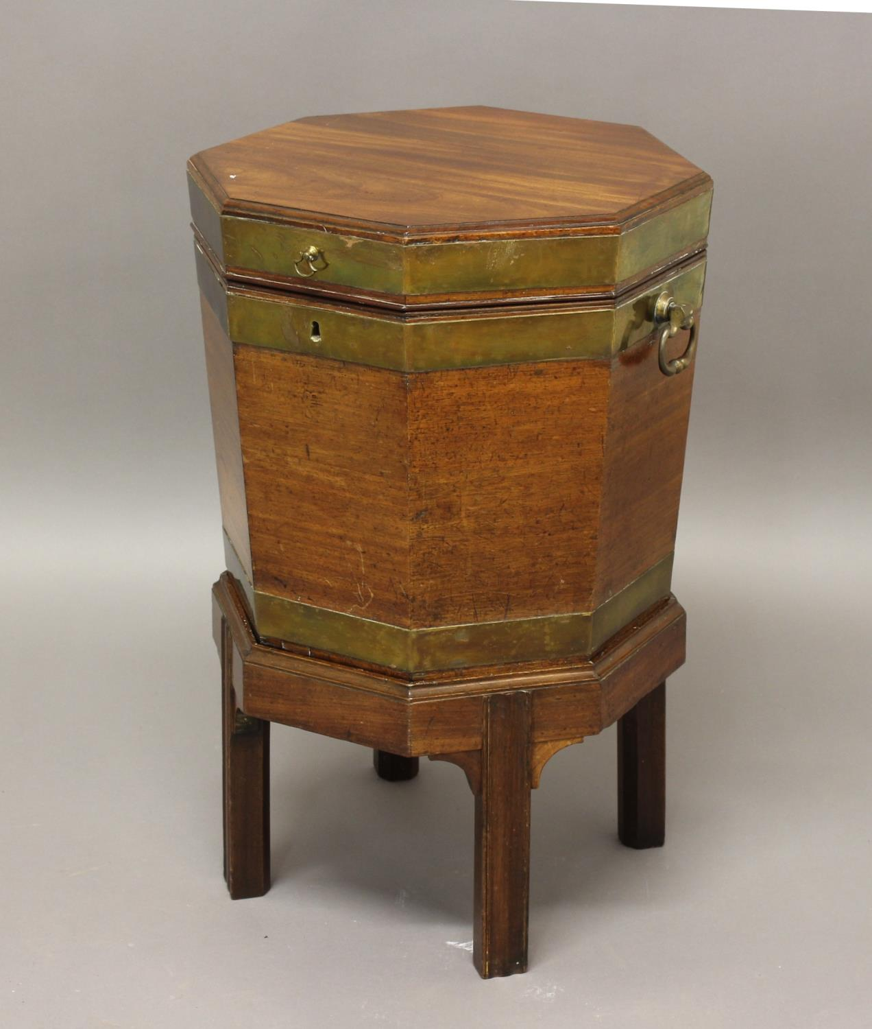 A GEORGE III BRASS BOUND MAHOGANY WINE COOLER ON STAND, of octagonal form with lead lined