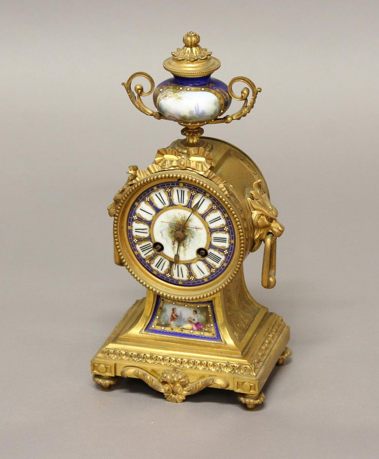A 19TH CENTURY FRENCH GILT & PORCELAIN MOUNTED MANTEL CLOCK, with a 3 1/2 inch painted porcelain