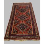 AN AFSHAR RUG, c.1910, South East Iran, the pale brick red field with three stepped indigo