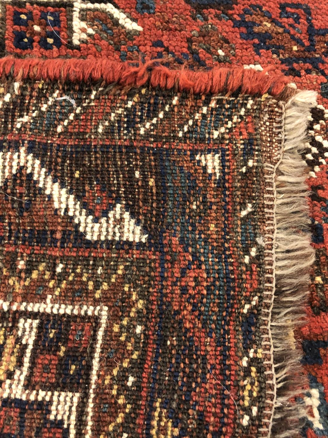 A KHAMSEH CARPET, South West Iran, c.1920, the madder field richly decorated with tribal motifs, - Image 2 of 2