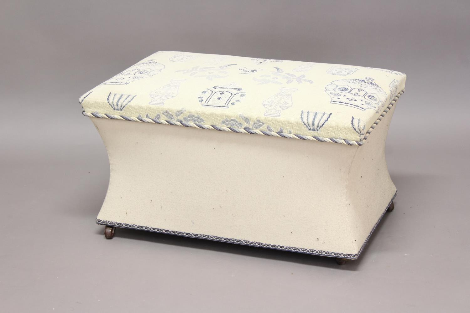 A VICTORIAN STYLE UPHOLSTERED BOX OTTOMAN. The rectangular box ottoman upholstered in blue and white