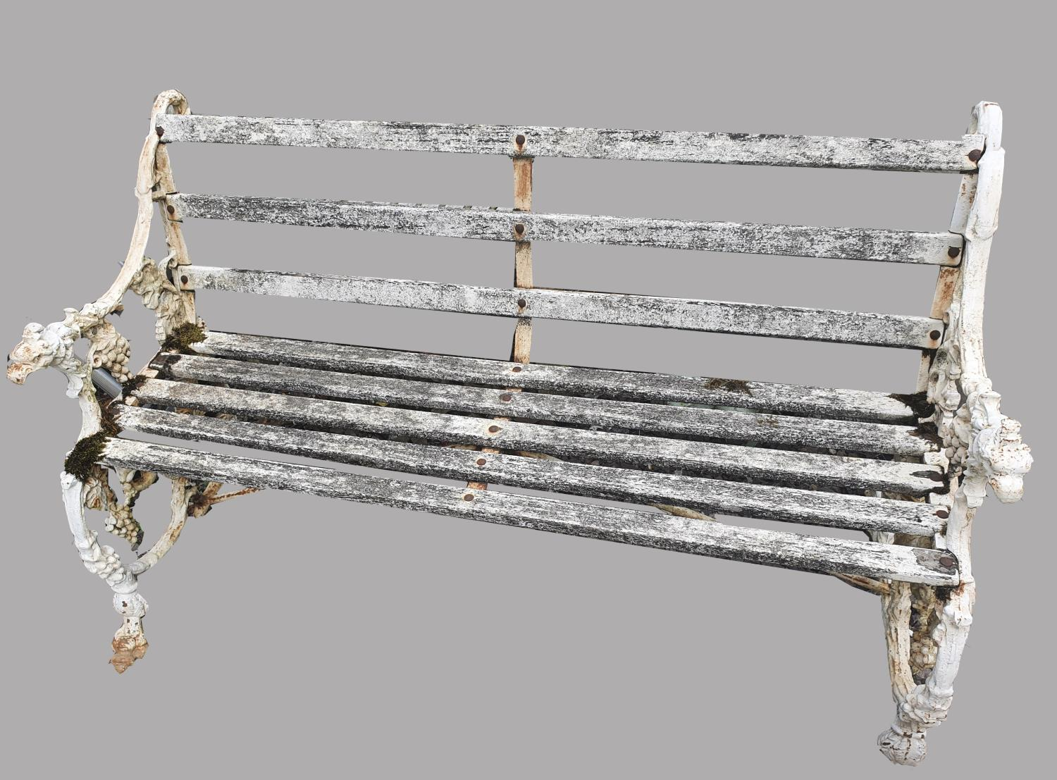 A VICTORIAN 'FURNESS RAILWAY' CAST IRON GARDEN BENCH. The ends cast with squirrels eating grapes,