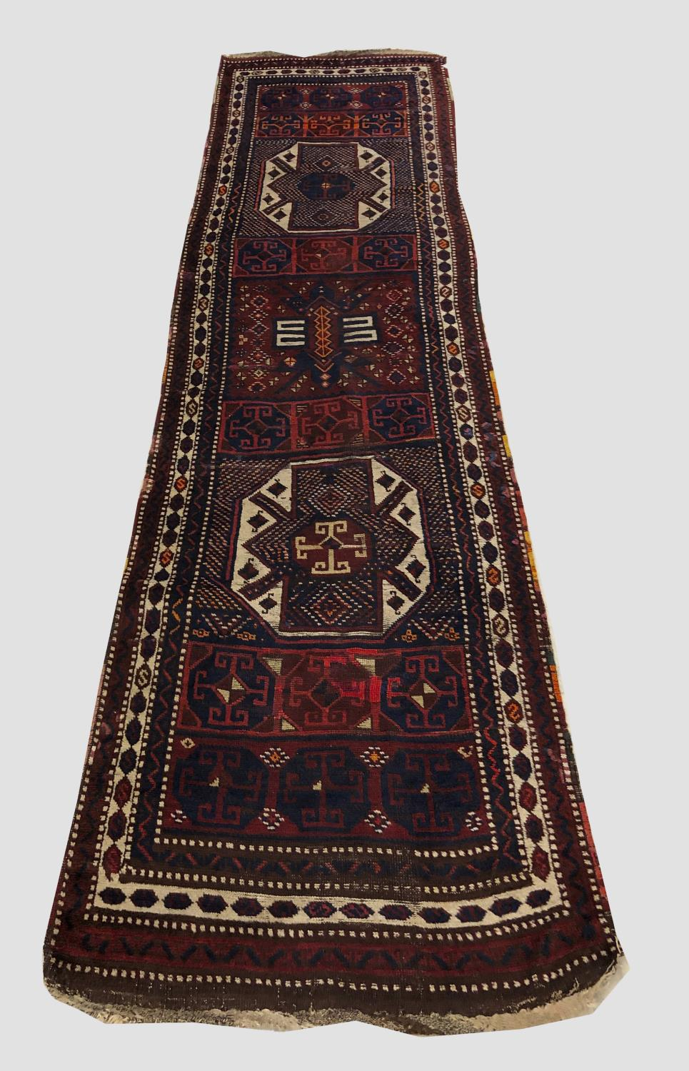 AN EAST ANATOLIAN RUNNER, c.1900, the compartmentalised field with two large octagons and