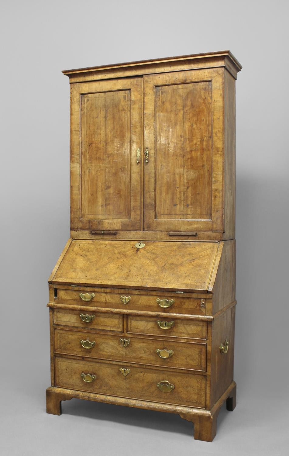 A GEORGE I WALNUT BUREAU CABINET. The upper section with a moulded cornice above twin panelled doors - Image 2 of 2