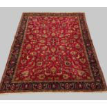 A TABRIZ CARPET, North West Iran, c.1950, the raspberry field with an all over design of angular
